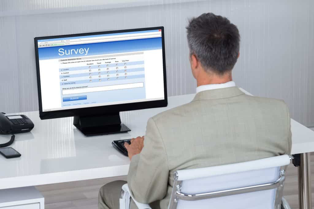 business man doing a survey on his computer