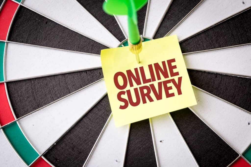 online survey note on a dart board
