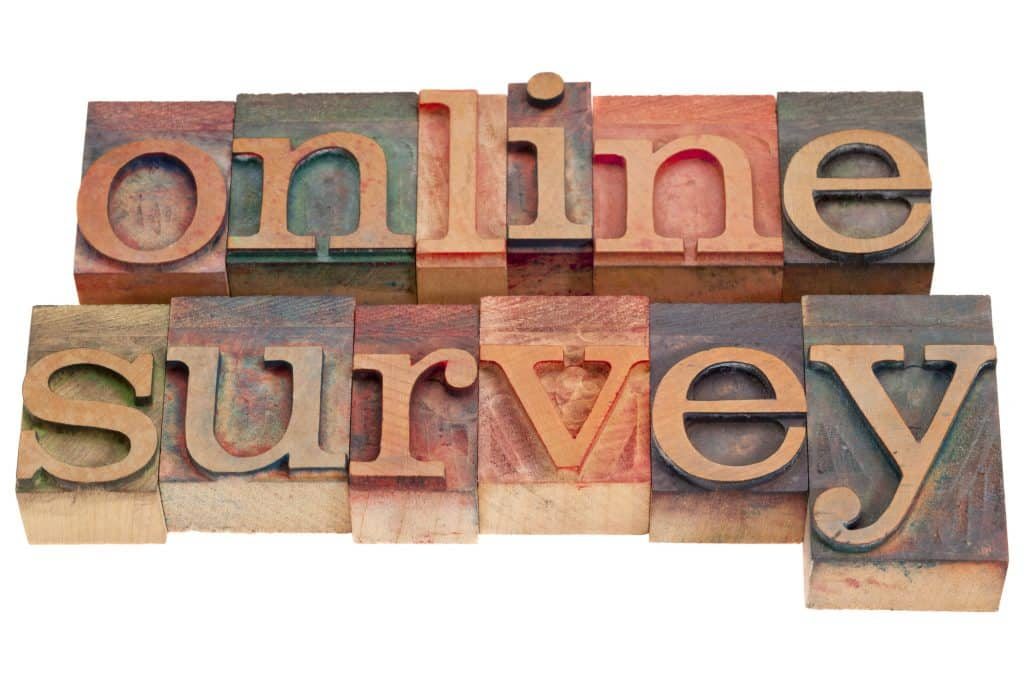 online survey word written in colorful wooden letters
