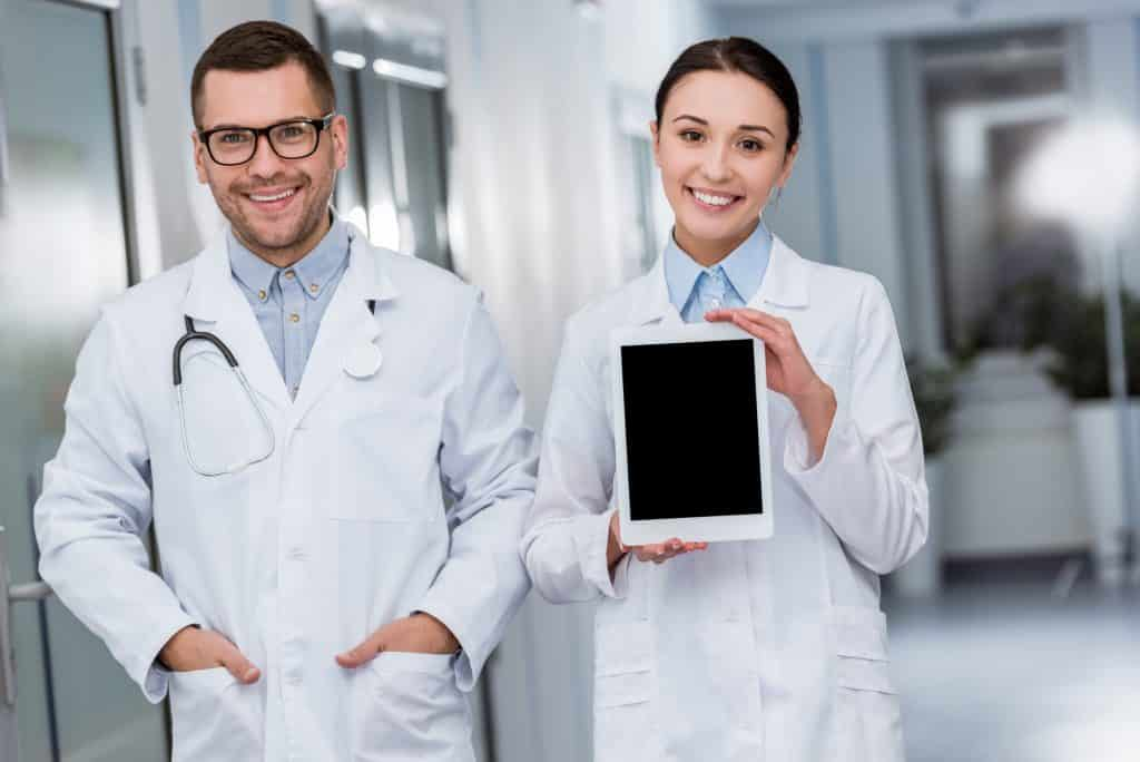doctors holding a tablet for doing online surveys
