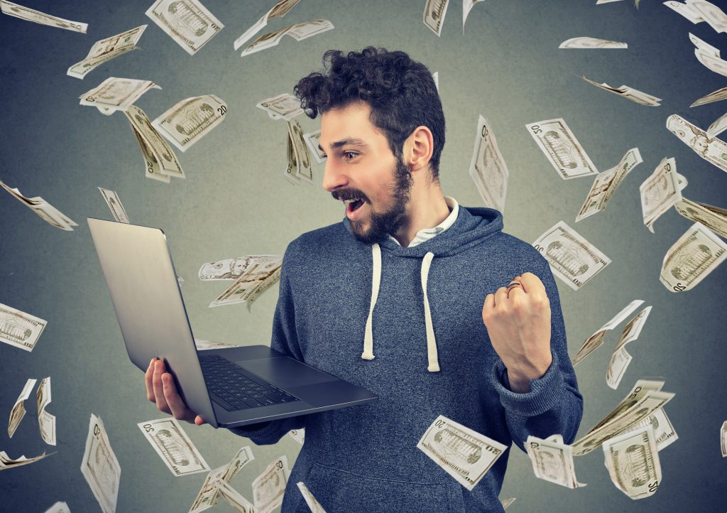 man earning money online with his laptop