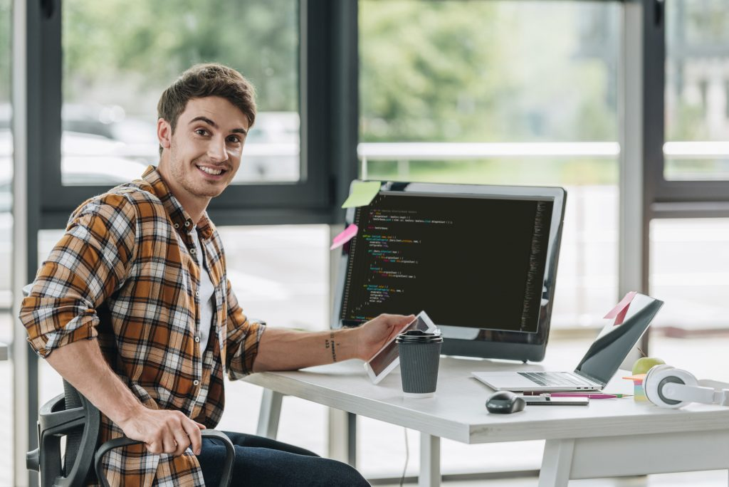 happy man thinking about building wordpress themes