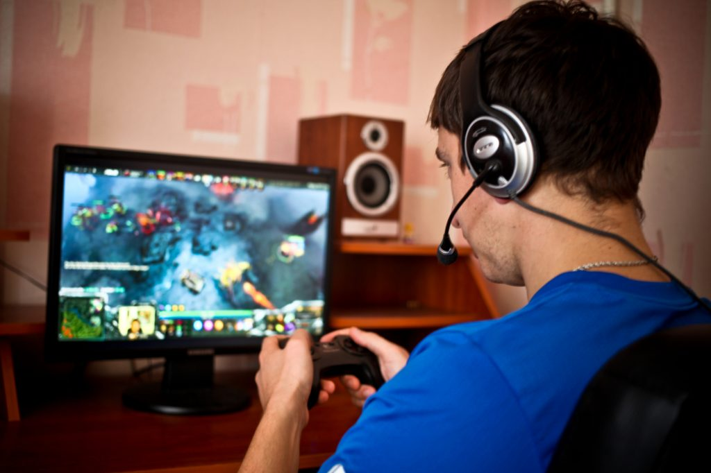 man playing and streaming a game