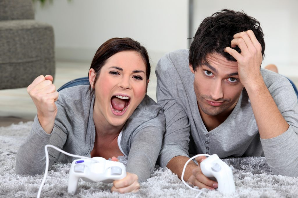 man and woman playing games together