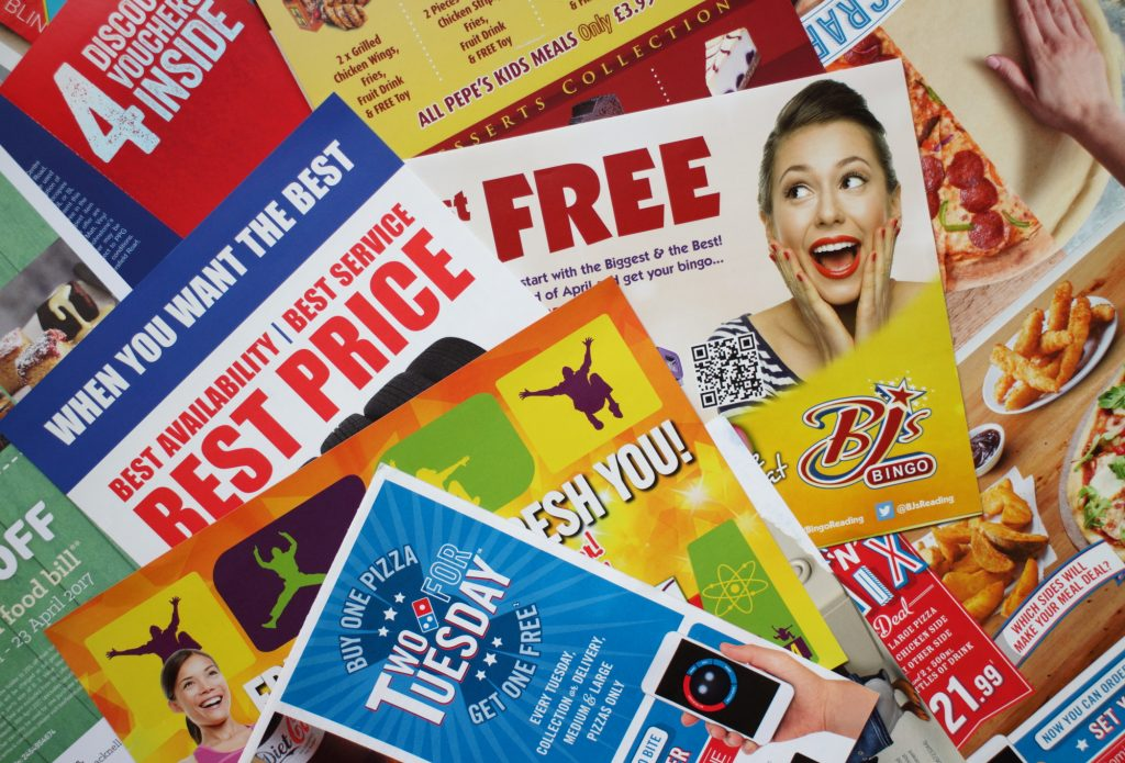 various junk mail and brochures