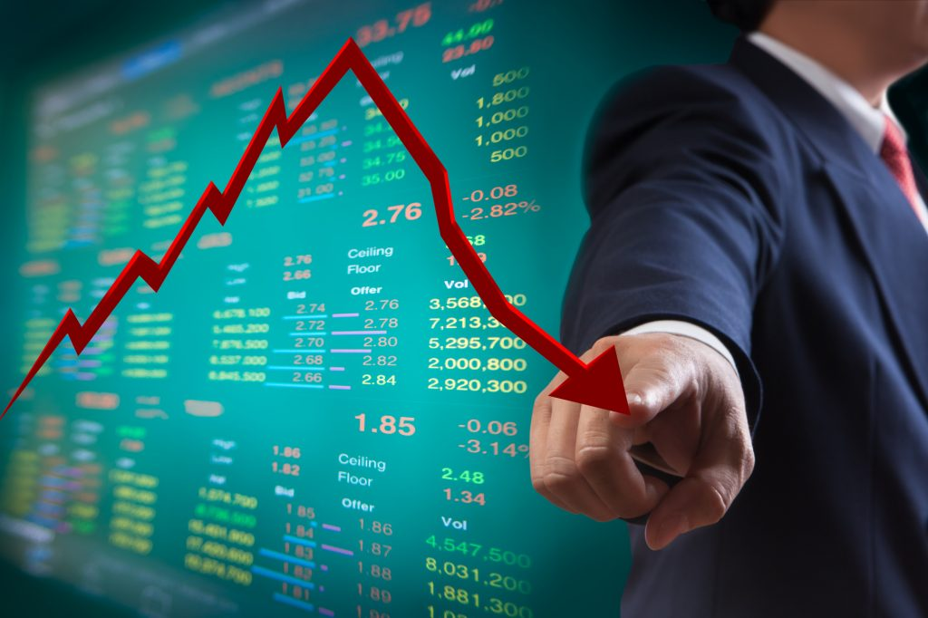 businessman using his finger to follow the stock market trend
