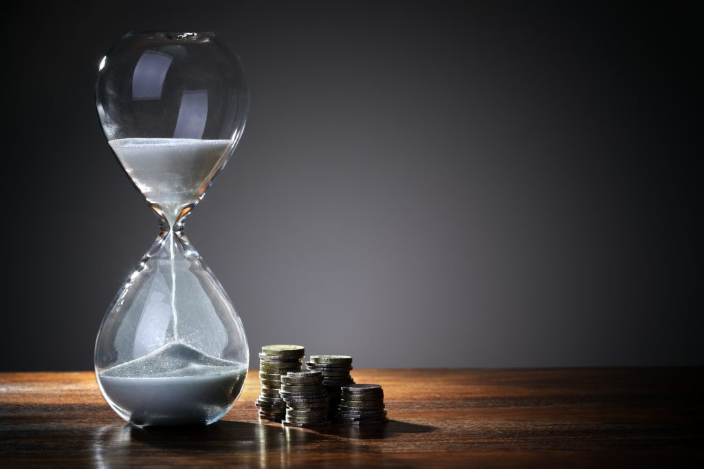 hourglass representing time for earning bucks