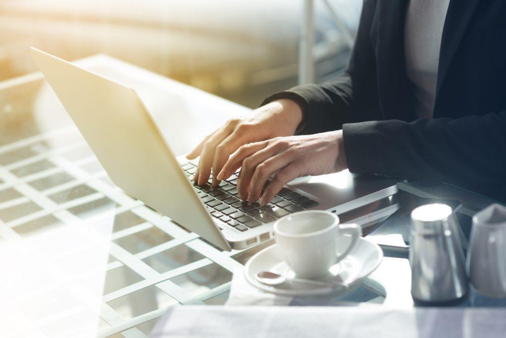 man doing creative writing tasks on his laptop