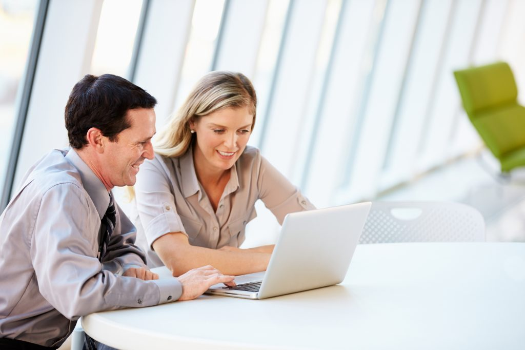 man and woman doing get paid to tasks on laptop
