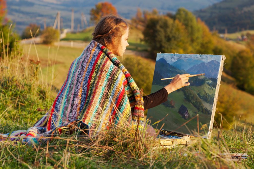 Artist painting and thinking about the perfect wordpress theme