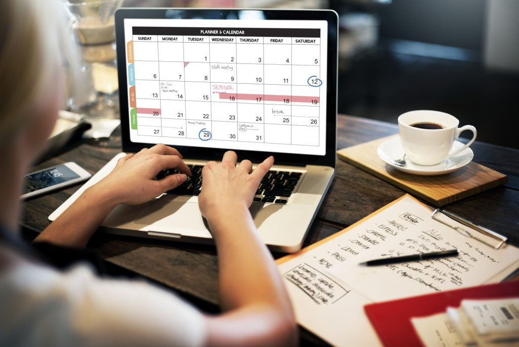 lady setting up a calendar on her wordpress website