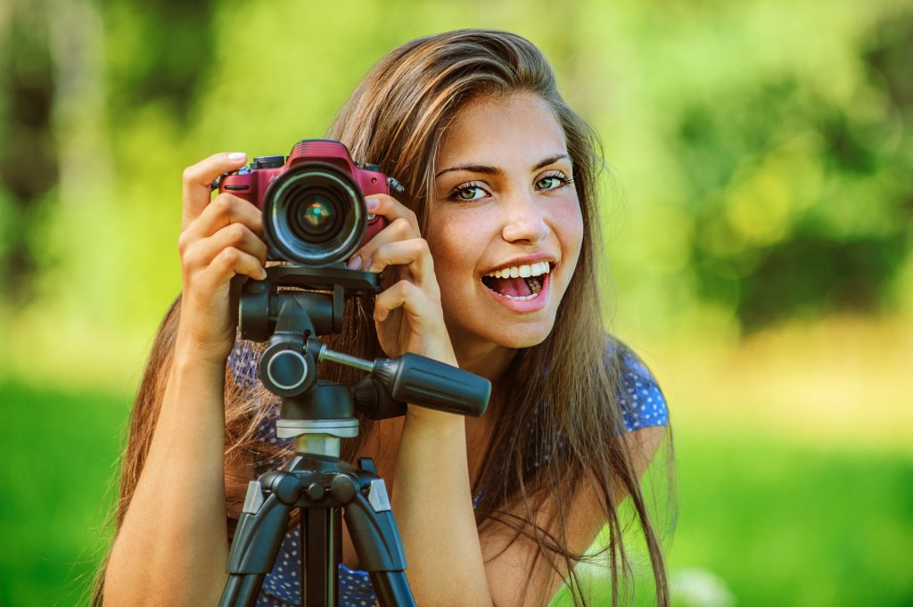 photography girl smiling behind the camera
