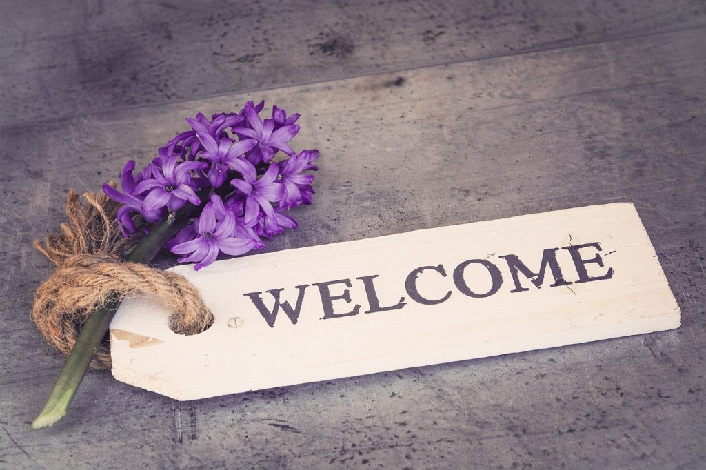 welcome page with a flower on it