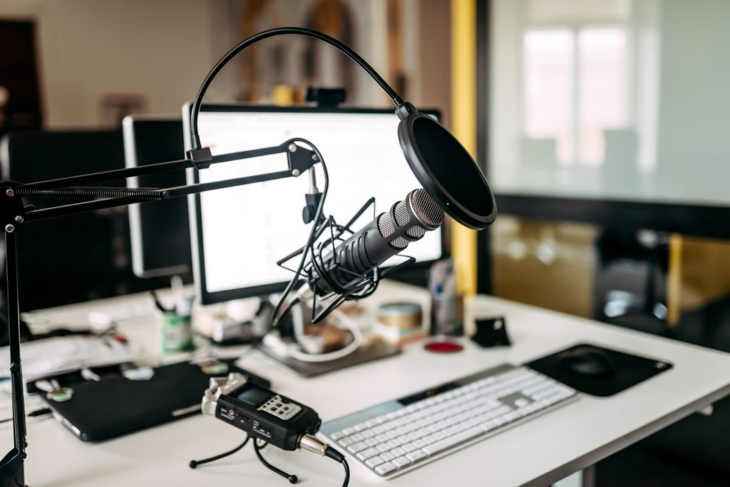 wordpress podcast website behind the microphone